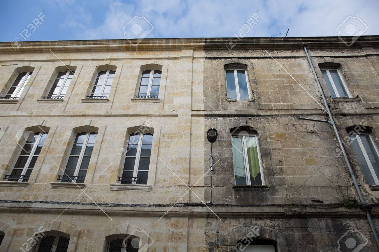 Difference between a wash cleaned house facade and a dirty one in a city - 68827067