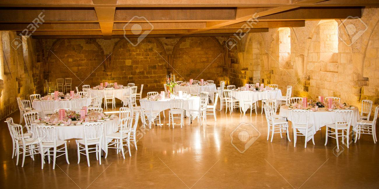 The interior of a large reception room ready to receive guests for the great part of the evening - 76877959