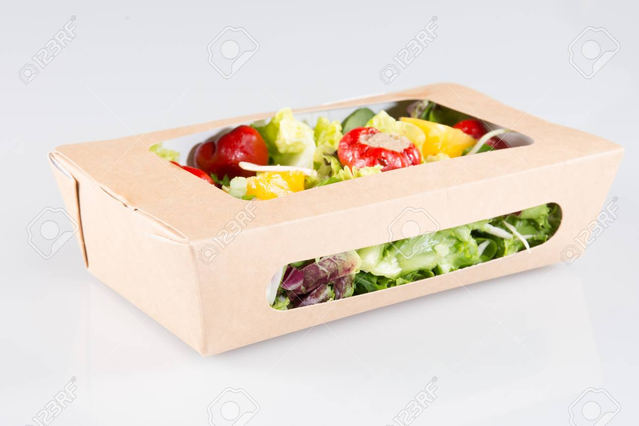 fast food with salad in a box on a white background - 95174789