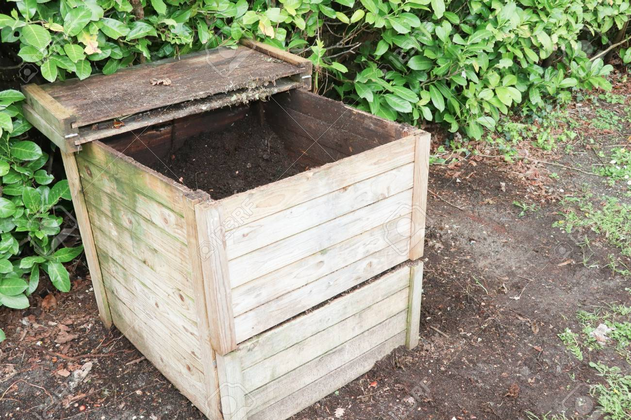 Small wood outdoor composting bin for recycling kitchen and garden..