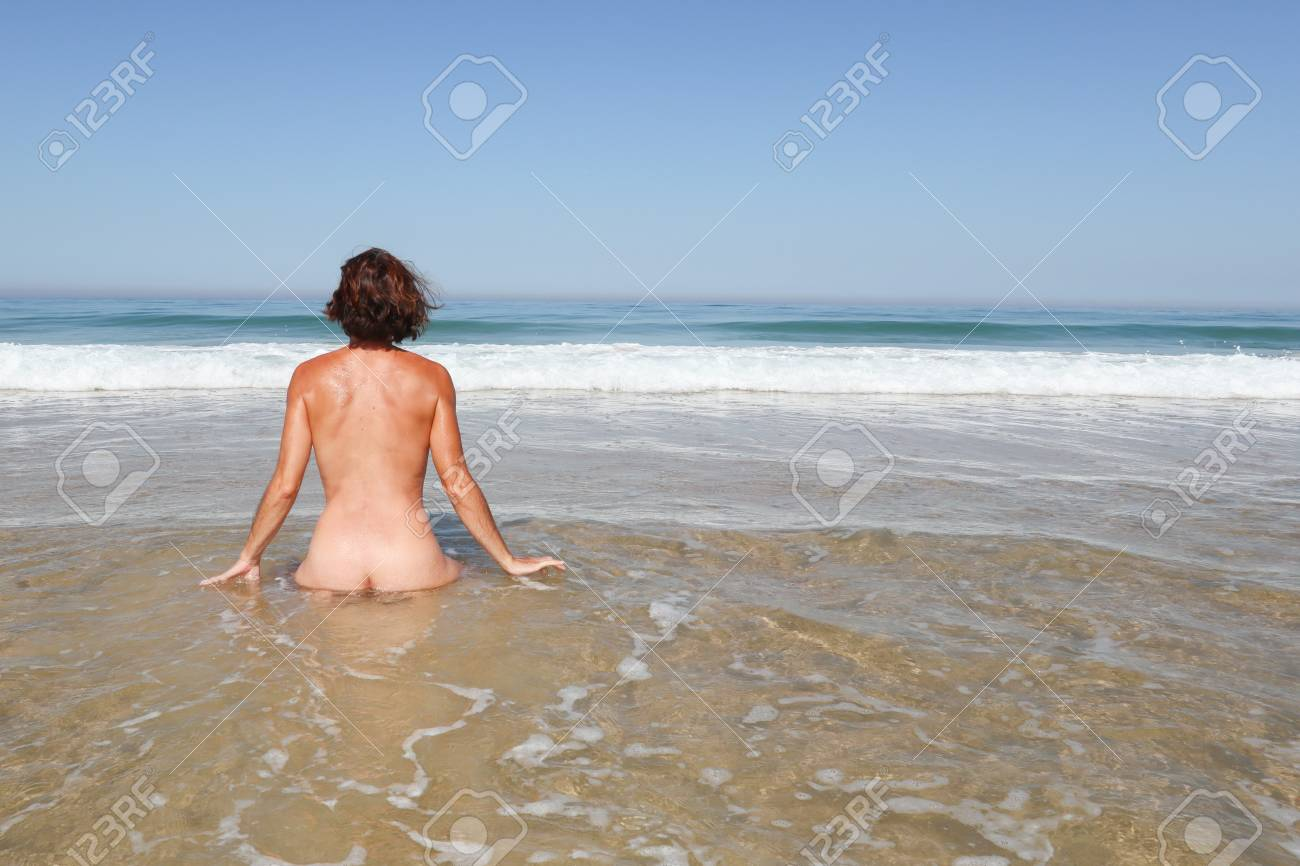 Alone naked on the beach