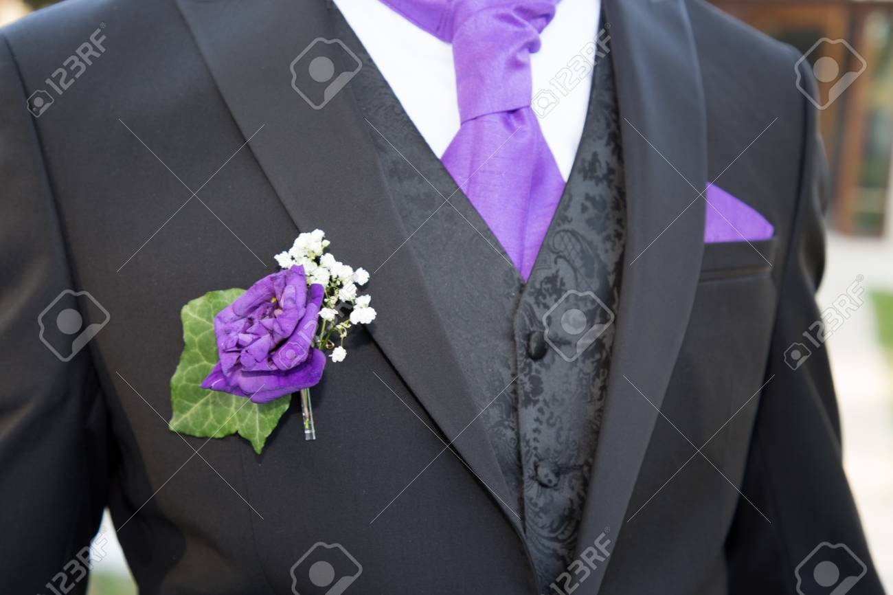 Close Up Of Beautiful Black Purple And White Wedding Groom Suit