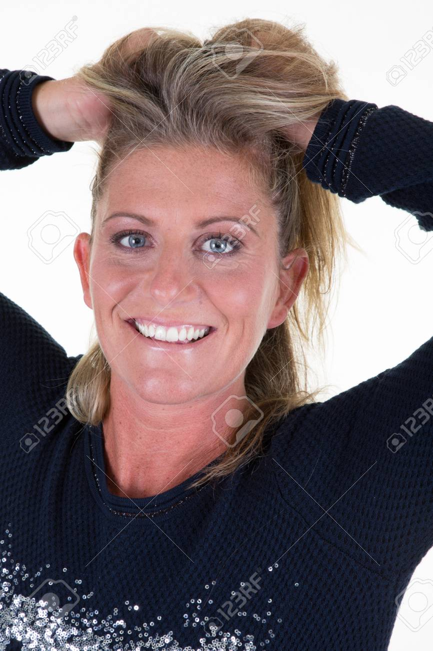Blonde Middle Aged Woman With Hands In Hair Stock Photo Picture And