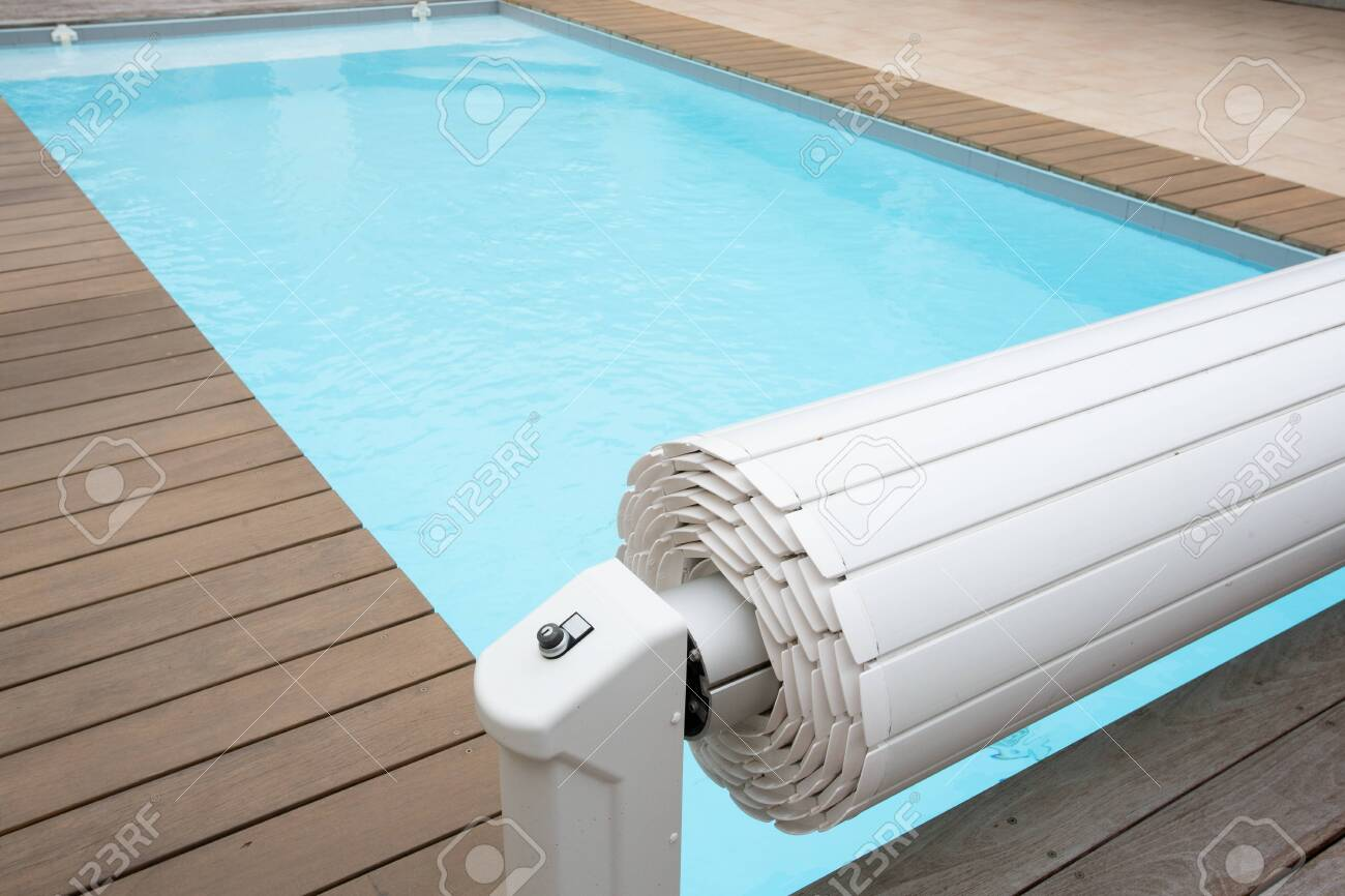 white rolling shutterpool protection on blue swimming pool cover