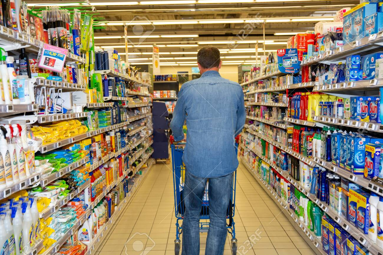 Bordeaux , Aquitaine / France - 03 30 2020 : Back of man walking in supermarket with shopping cart - 144639672