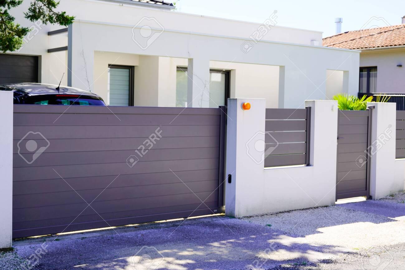 street suburb home grey brown dark metal aluminum house gate slats garden access door - 146571729