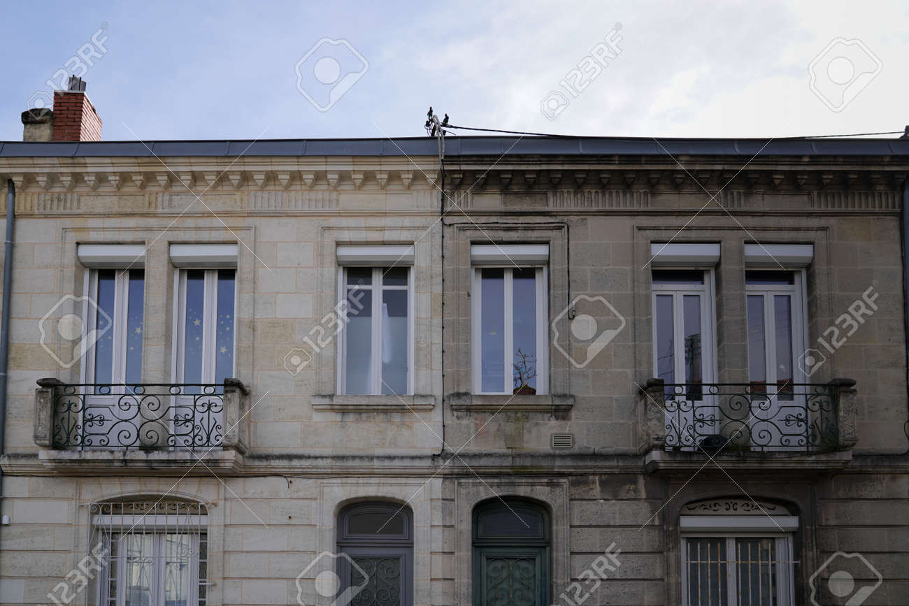 Outside renovation old building facades before and after cleaning washing wall house with industrial pressure water in facade exterior - 163255130