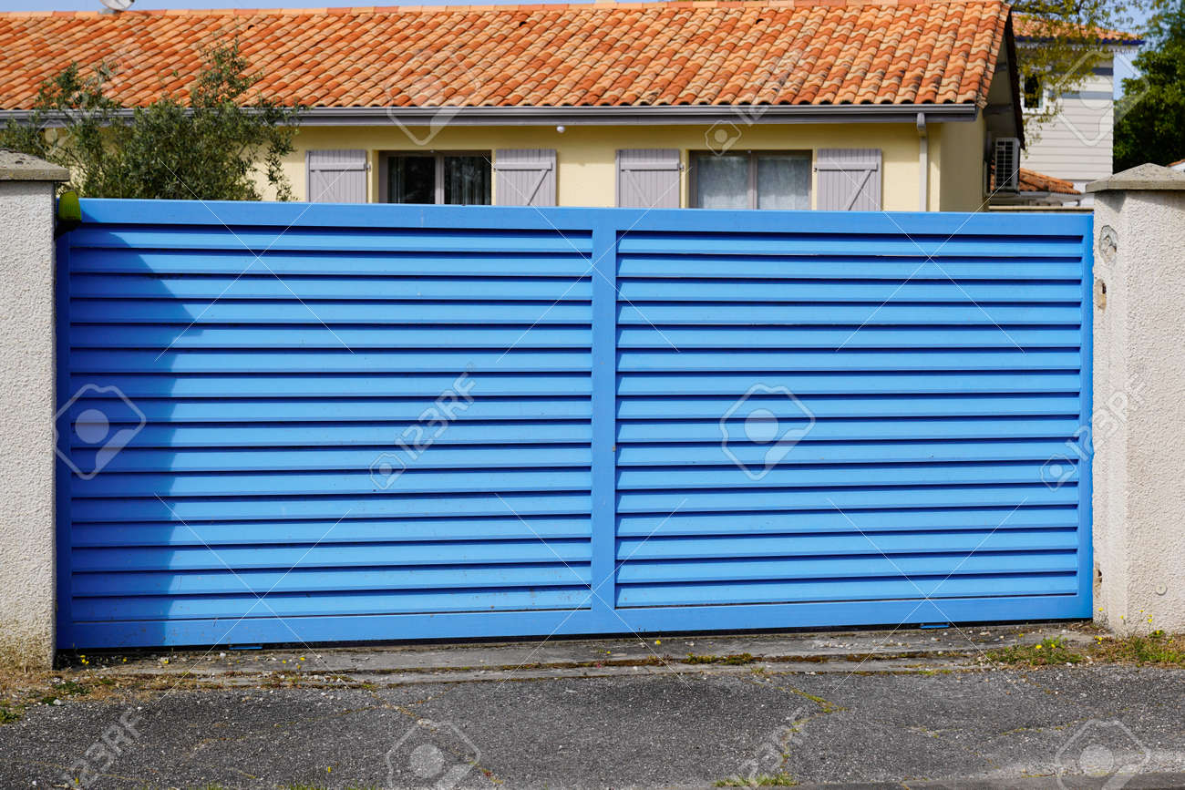 Blue classic portal sliding modern house gate door to access garage home garden - 167758925
