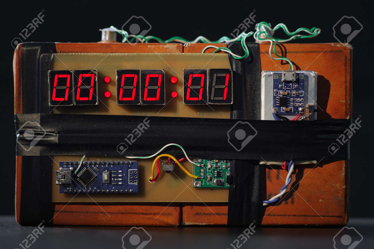 Bomb with red timer on black background. Improvised explosive device. Terrorist threat. Dynamite with clockwork. Explosives with detonator. Time bomb is going to explode or detonate per 1 second. TNT - 160156719