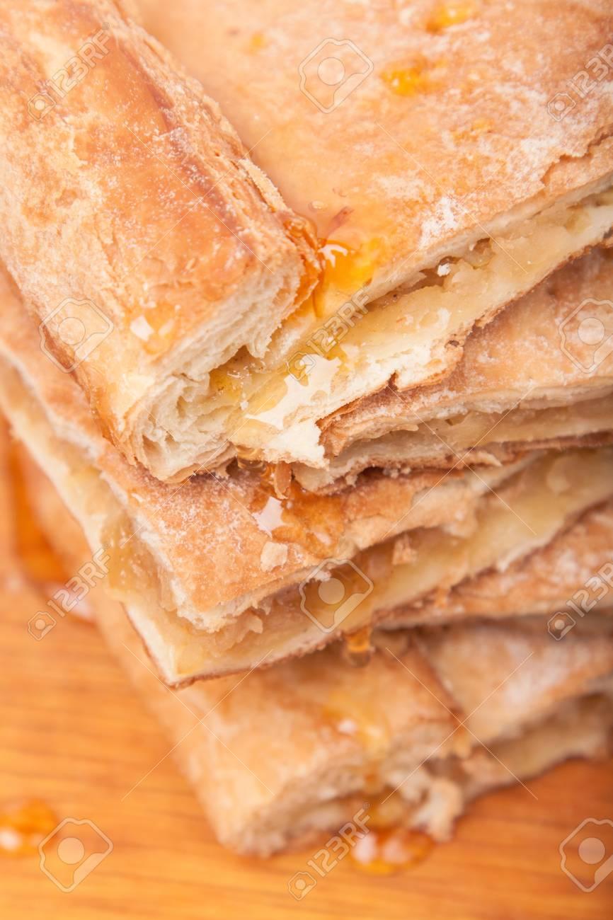 piece of slice thin sweet pie on wooden board Stock Photo - 17316368