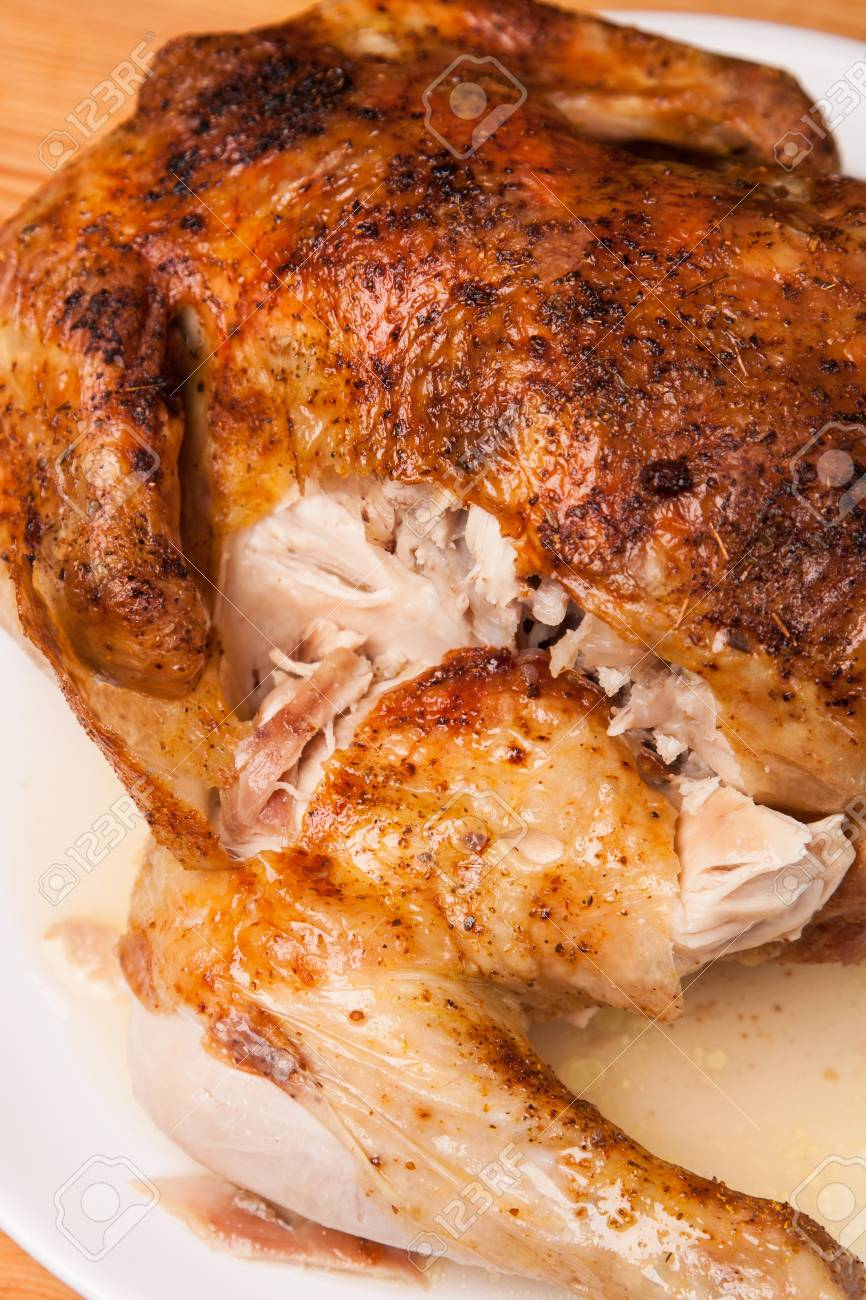 roast chicken on white plate and wooden background Stock Photo - 17718633