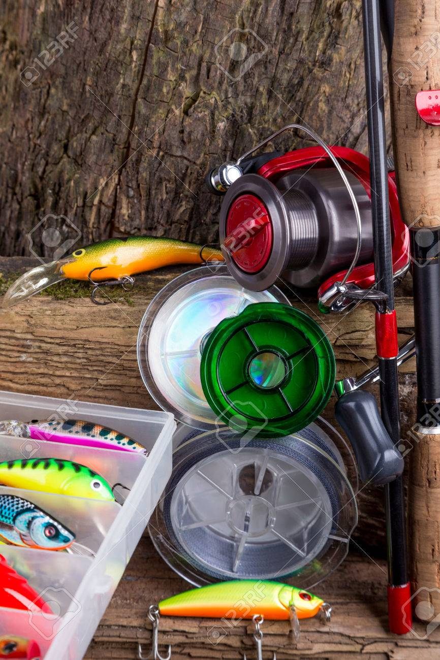 uk availability 0e100 96498 fishing tackles and fishing baits on wooden background. Idea..