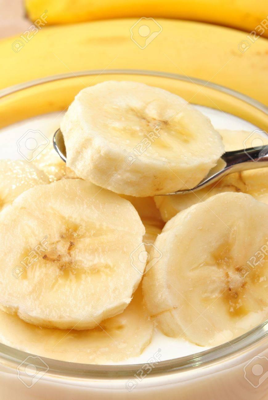 some organic banana slices  in natural yoghurt Stock Photo - 7990743
