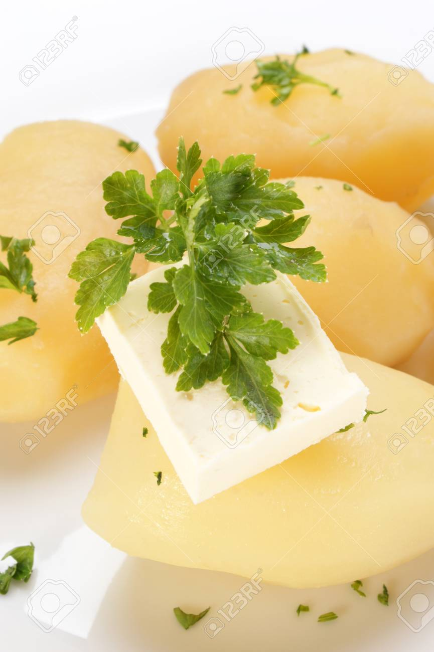 Parsley and butter on boiled potatoes Stock Photo - 9390897