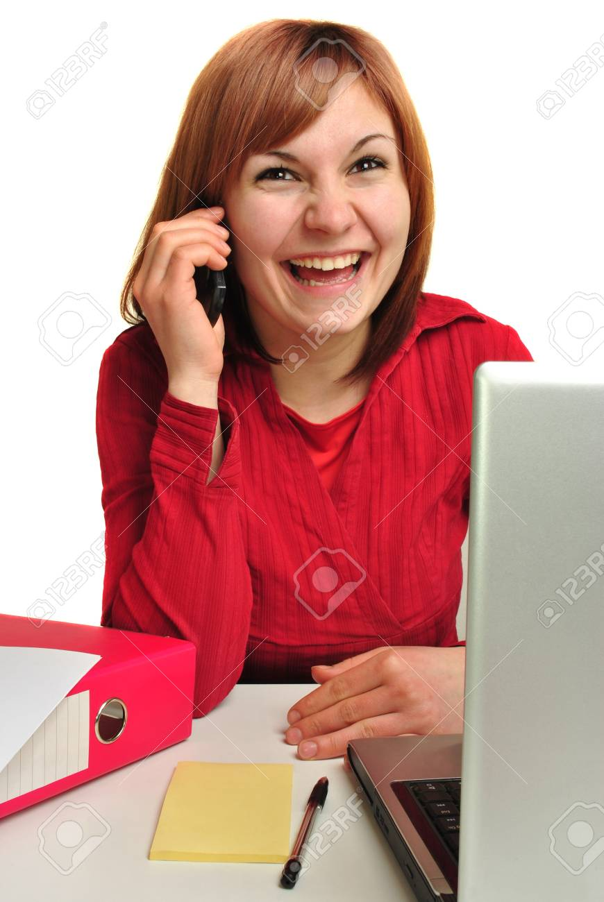 Office Assistant at the phone, happy and laughing Stock Photo - 9463375