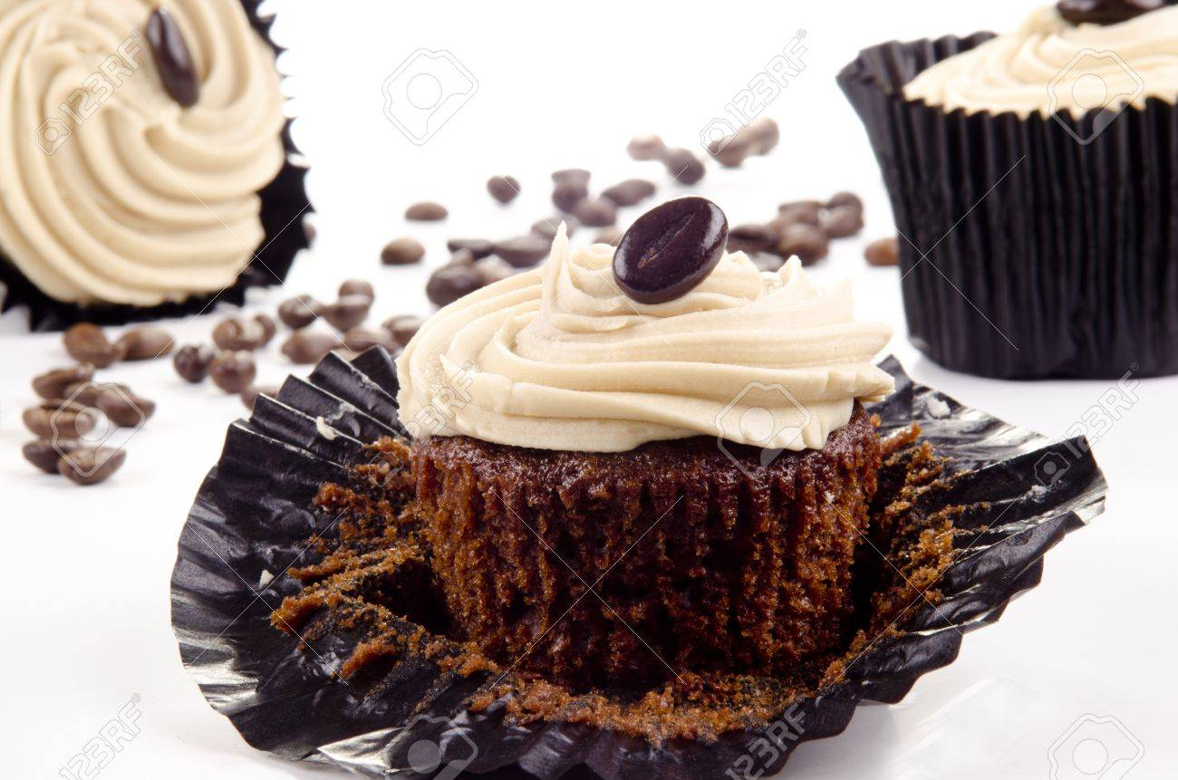 homemade coffee cupcakes and coffee beans in the background Stock Photo - 10981612