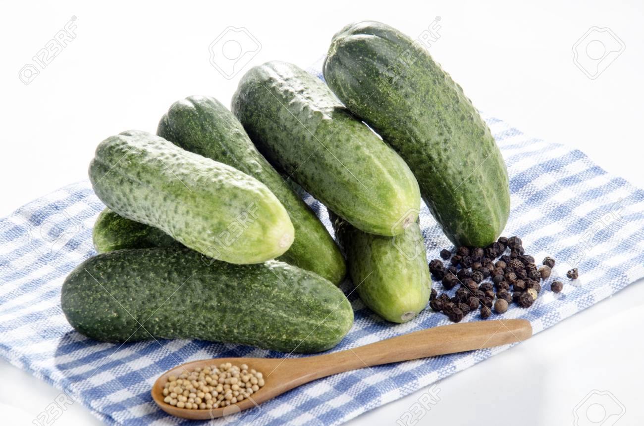 pickles with pepper corns and mustard seed on a kitchen towl Stock Photo - 14619915