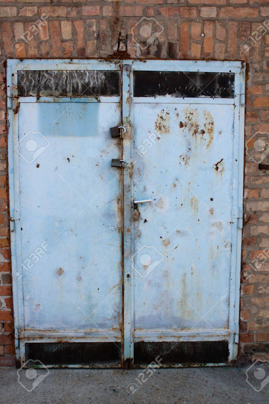 The Old Factory Metal Door With Brick Wall Stock Photo   9938333