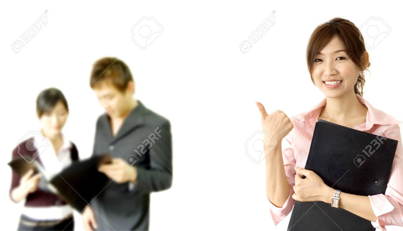 smiling business woman holding a file with her team members Stock Photo - 2852140
