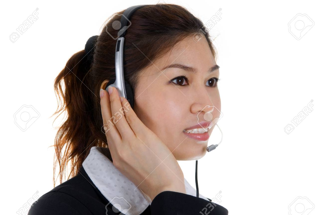 Friendly Customer Representative with headset smiling during a telephone conversation Stock Photo - 4390509