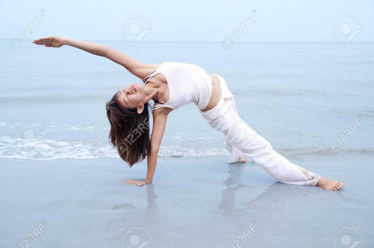 Woman practising Yoga(Gate Pose) on the beach. Stock Photo - 5766059