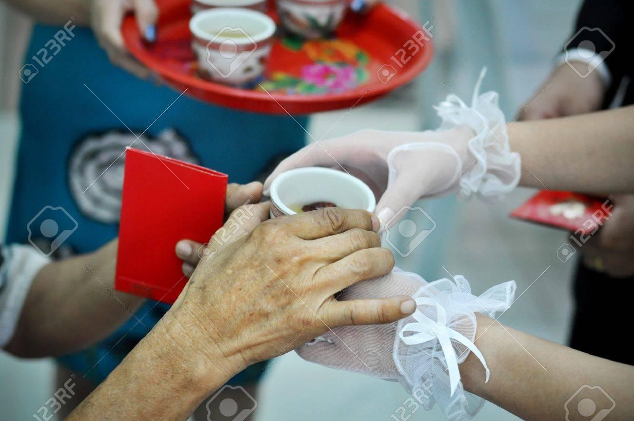 Chinese wedding tea ceremony serving to elders. Stock Photo - 7125117
