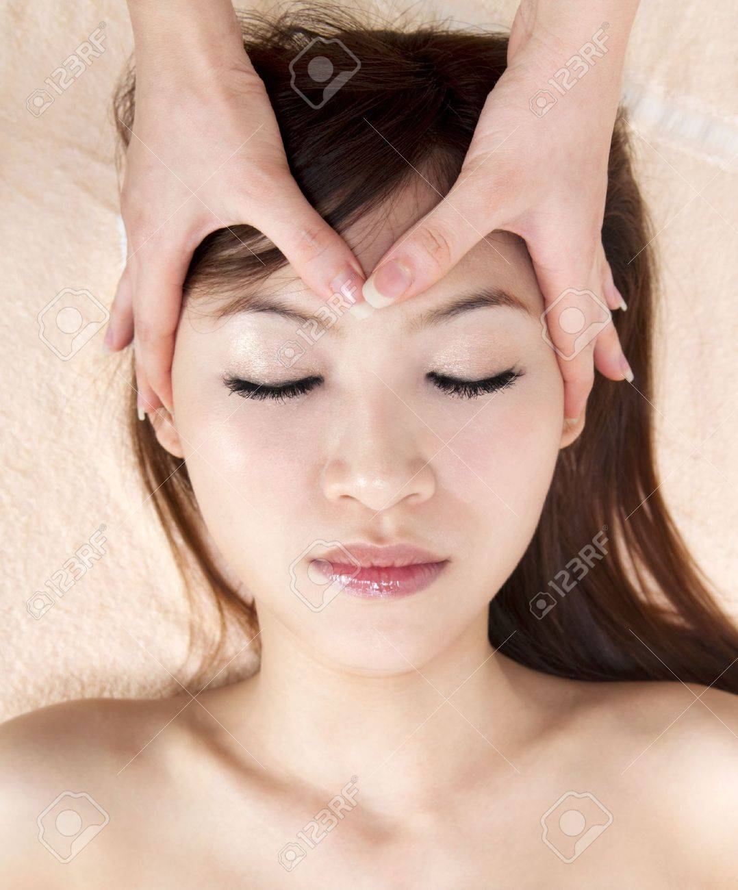 Beauty and Spa - Asian Girl having a massage on her head Stock Photo - 7863470