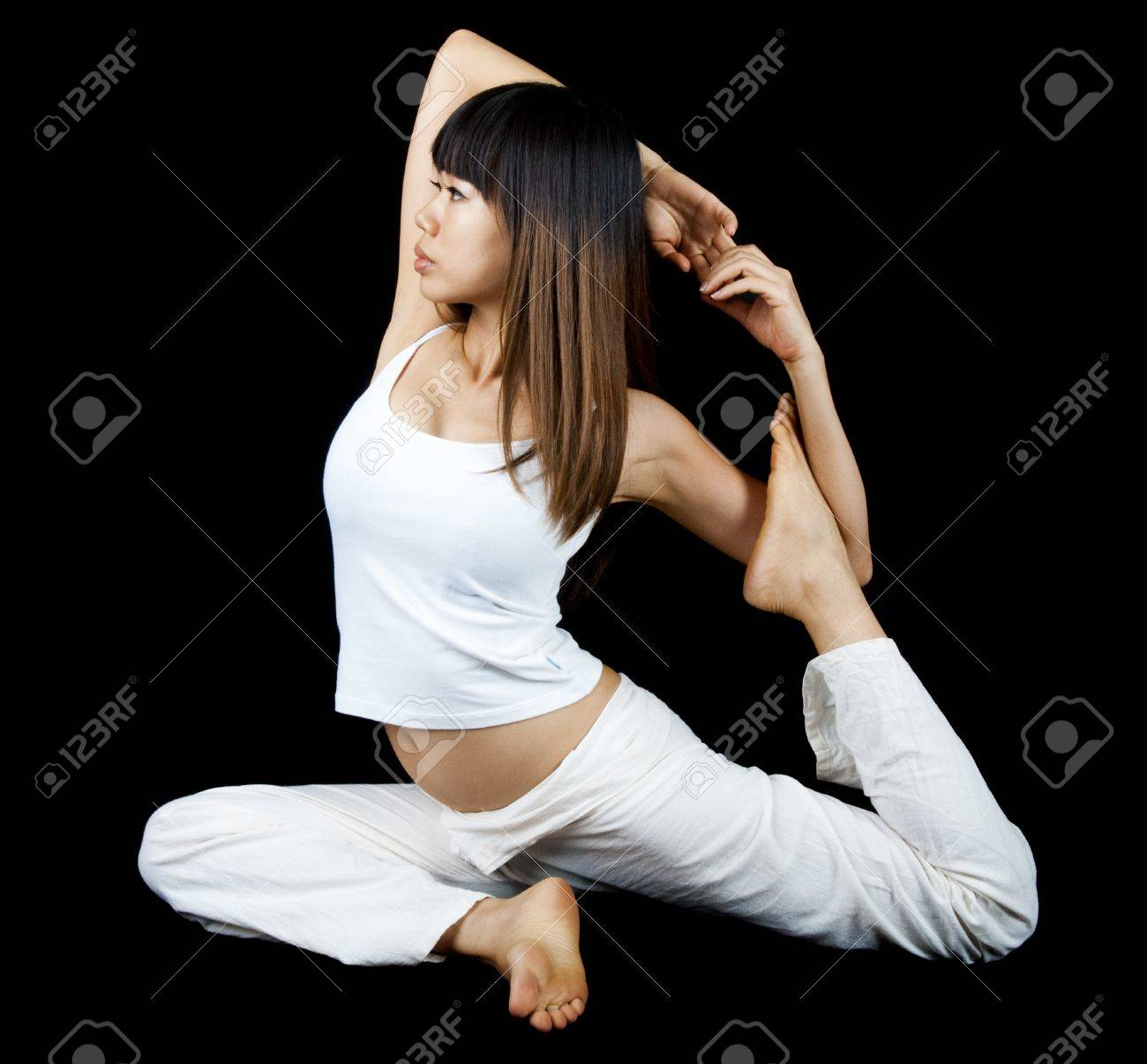 Woman in One-Legged King Pigeon Pose, on background. Stock Photo - 9043370