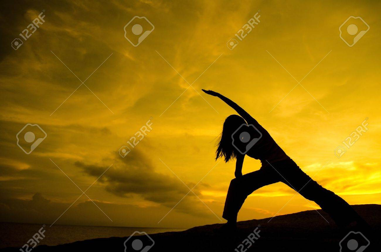 Silhouette of Woman Practicing Yoga (Warrior Pose) - 9507068