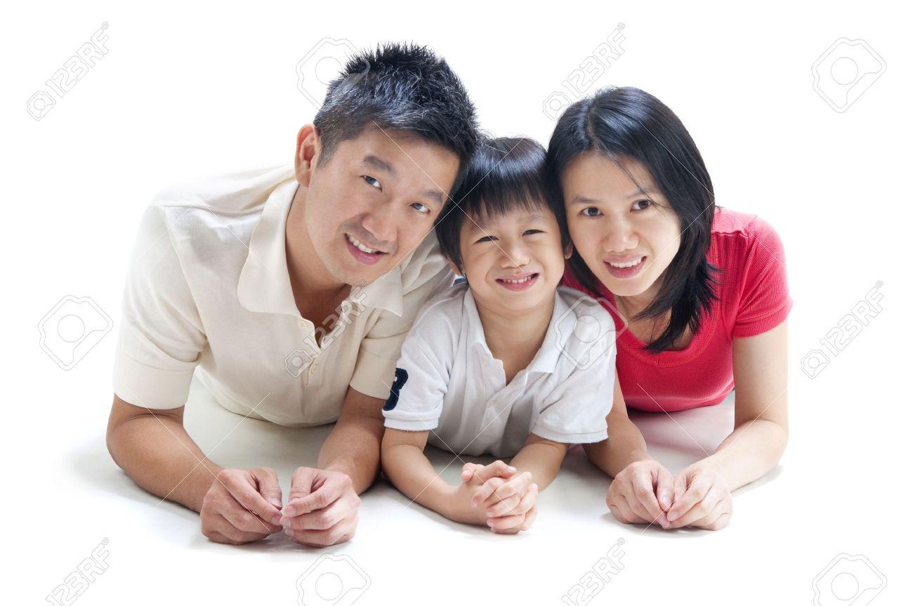 Happy Asian family on white background Stock Photo - 9899666