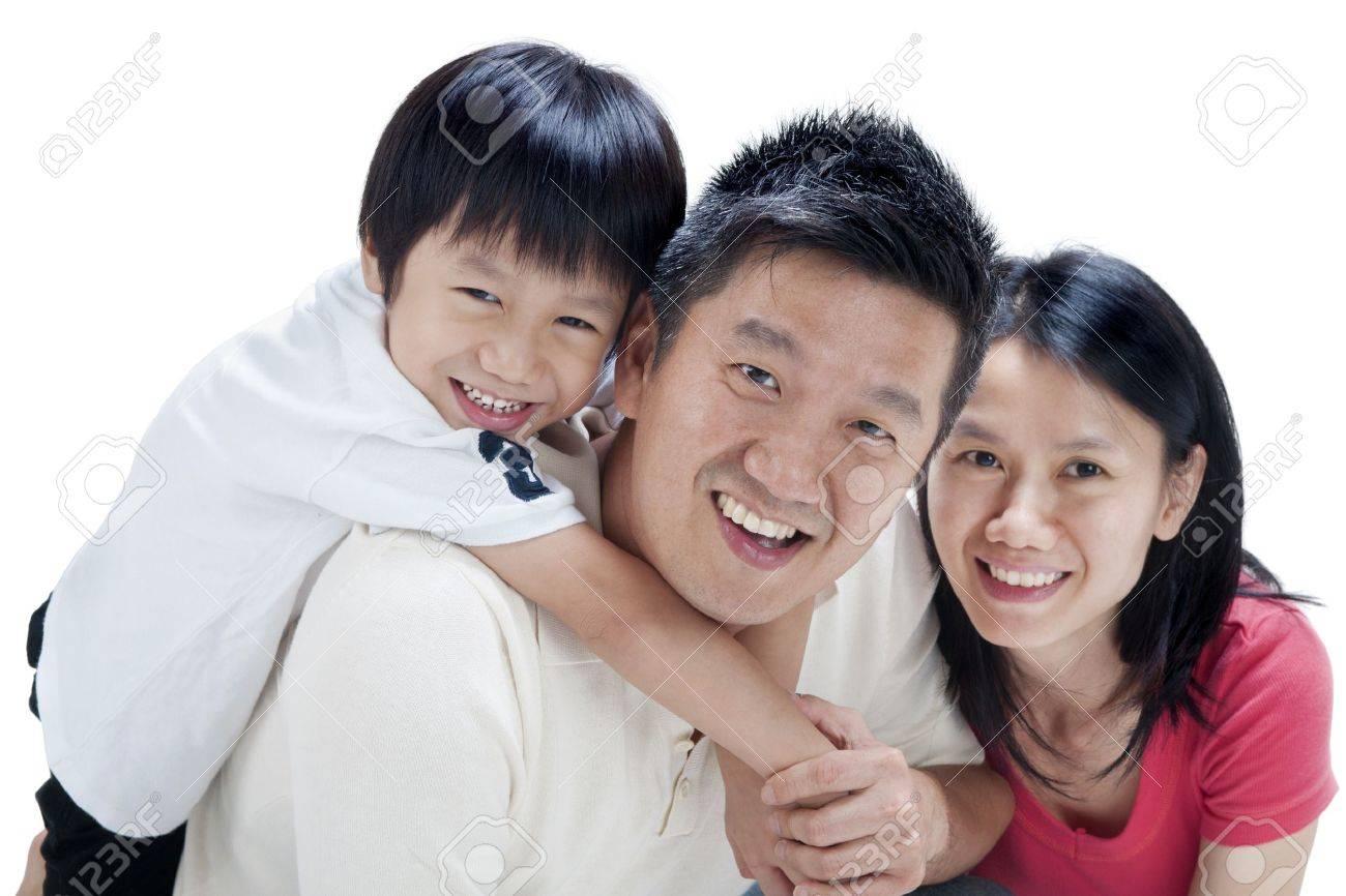 Happy Asian family on white background Stock Photo - 10934356