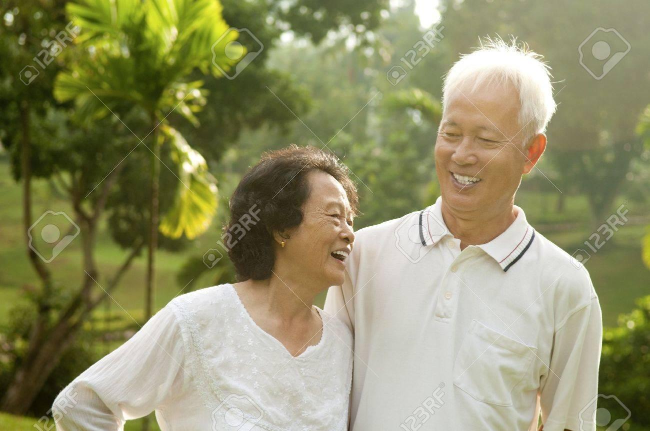 Asian Senior Couple having conversation at outdoor park Stock Photo - 11111510