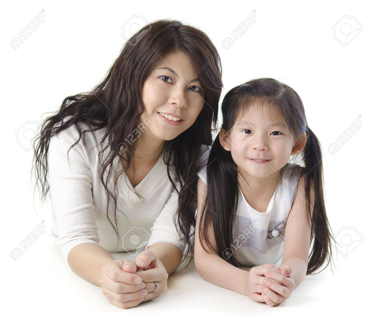 Asian mother and her daughter on white background Stock Photo - 11219177