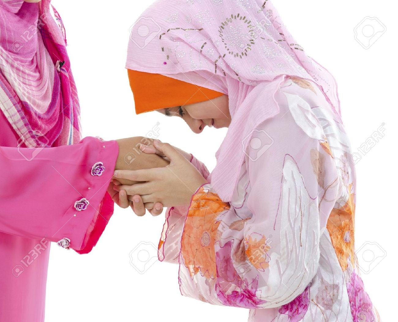 Young muslim women greeting to elders stock photo picture and stock photo young muslim women greeting to elders m4hsunfo