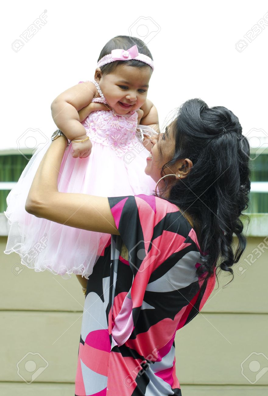 Indian mother playing with her baby girl Stock Photo - 13402546