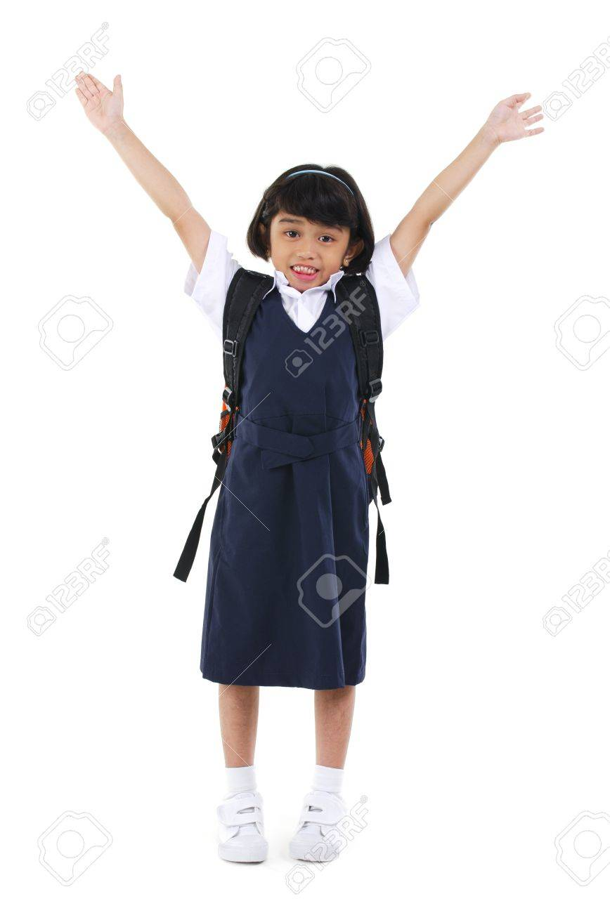 Six years old Southeast Asian school girl arms up in the air, fullbody over white background Stock Photo - 14639762