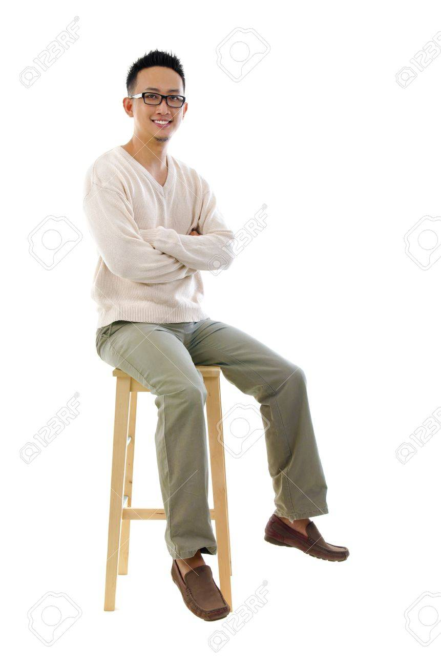 Full body Asian man sitting on a chair over white background Stock Photo - 14995311