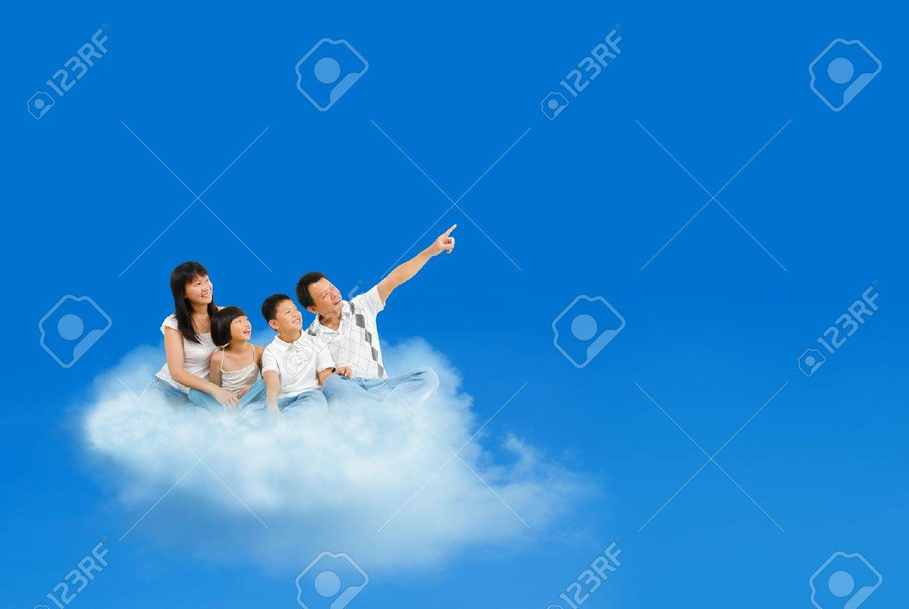 Happy Asian family sitting on cloud and pointing over blue sky Stock Photo - 15074881