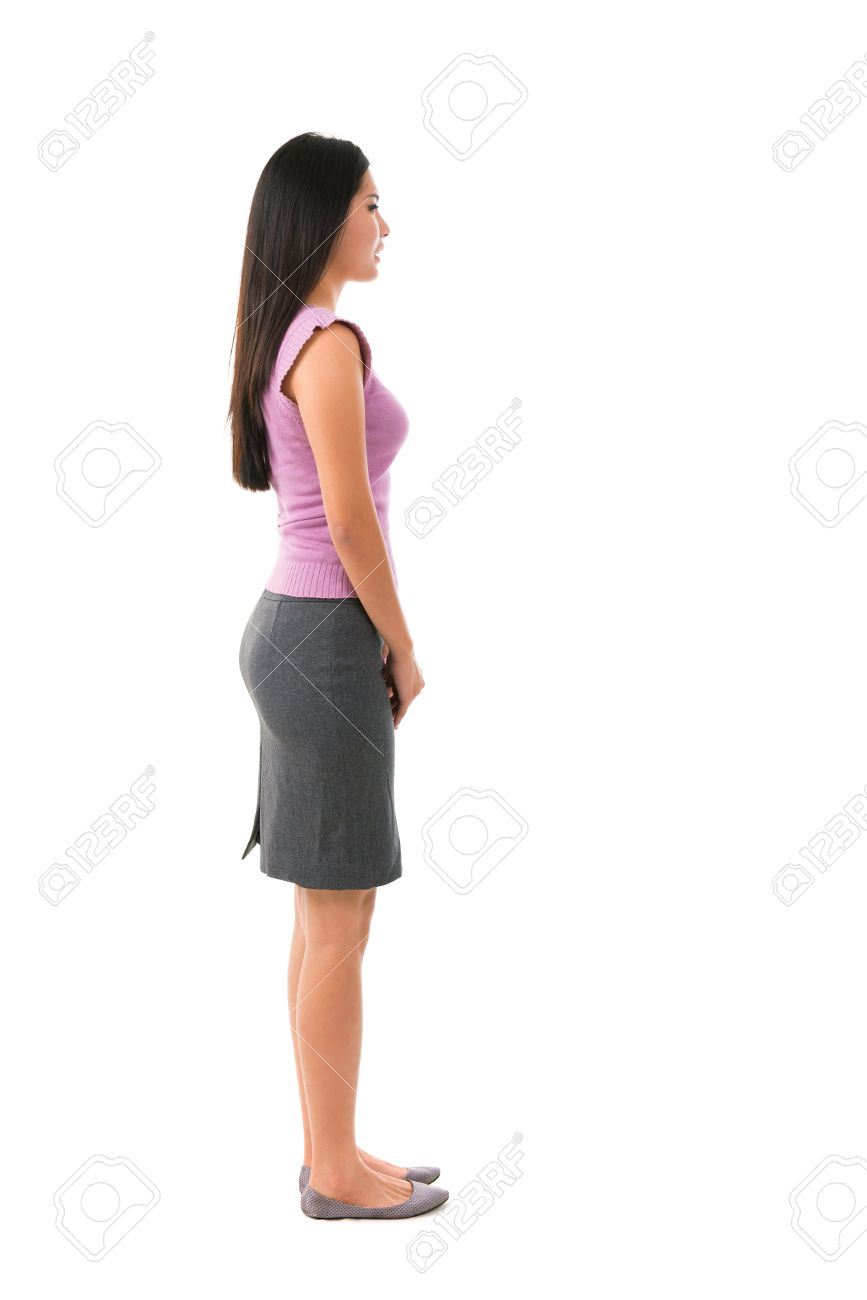 Side view full body of Asian female in office attire standing over white background - 15429802