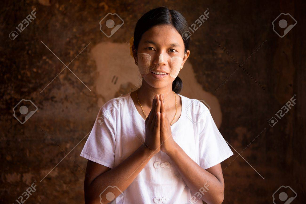 Myanmar woman in a traditional welcoming gesture Stock Photo - 16118470