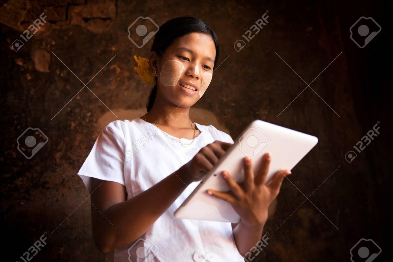 Myanmar girl using digital tablet computer. Stock Photo - 16118485