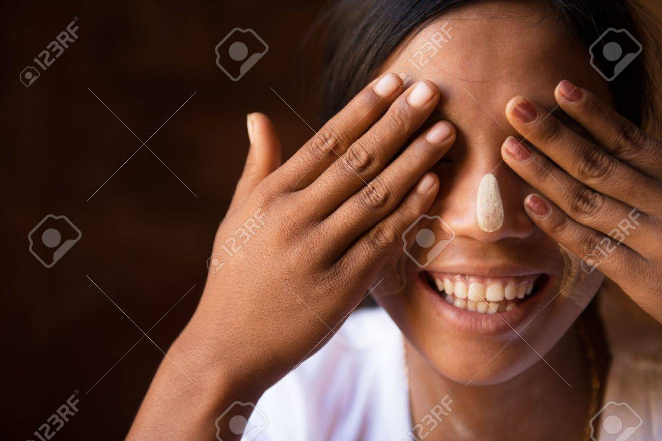 Shy Myanmar girl covering her eyes with hands Stock Photo - 16118496