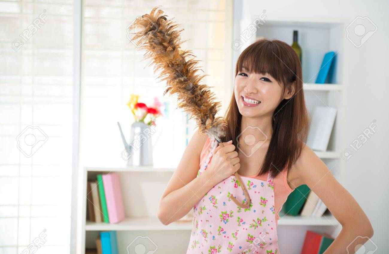 beautiful asian woman housekeeping with cleaning house stock photo