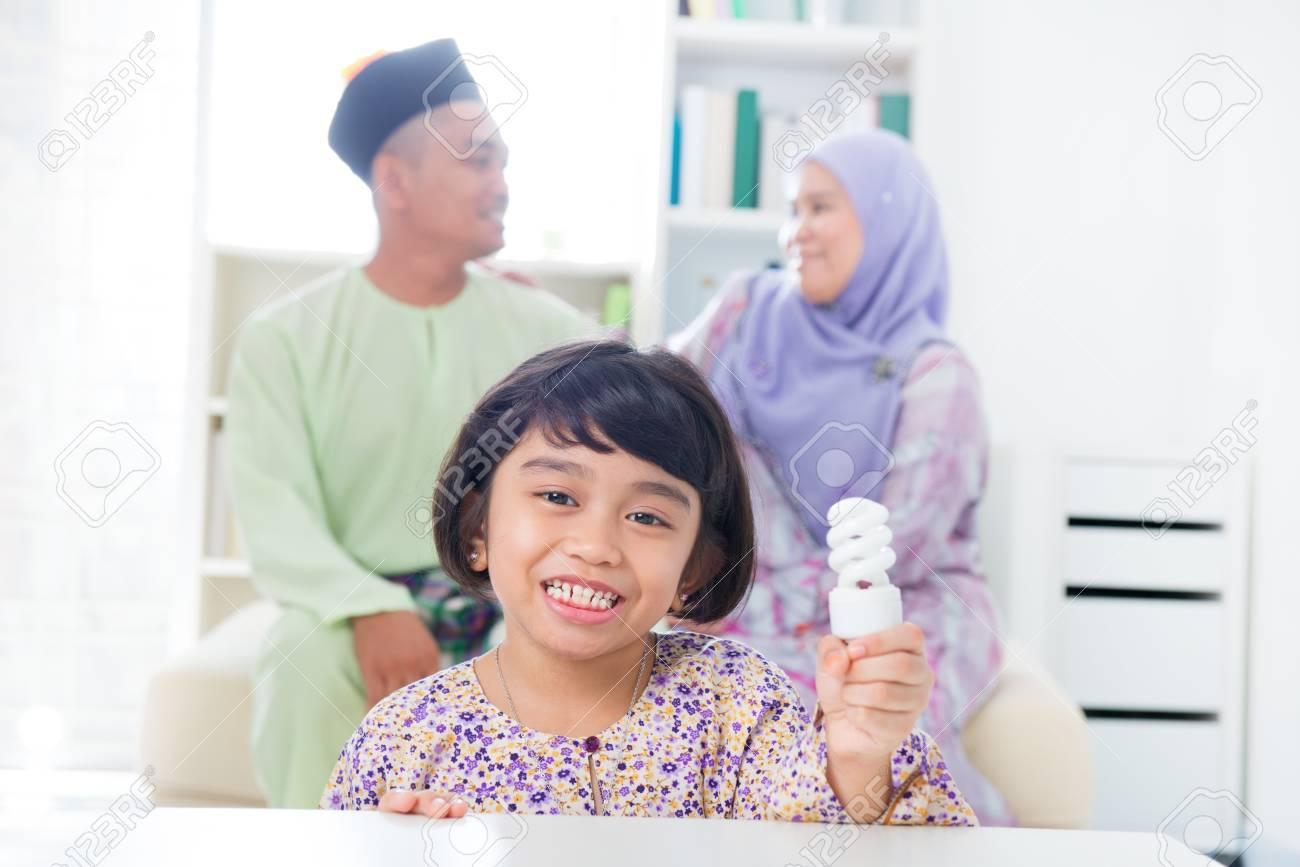 Muslim Southeast Asian girl lightbulb idea concept. Stock Photo - 17056485