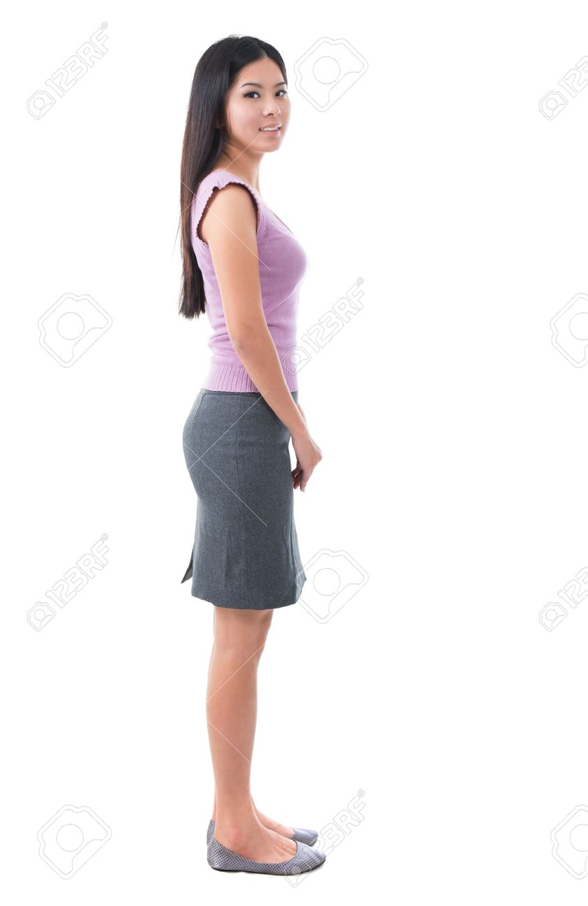 Full body side view Asian young woman standing on white background Stock Photo - 17500985