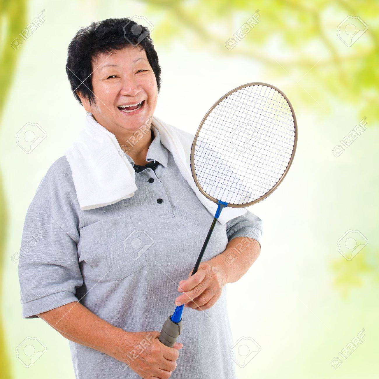 Asian senior woman healthy lifestyle. Happy Asian grandparent holding badminton racket Stock Photo - 18061149