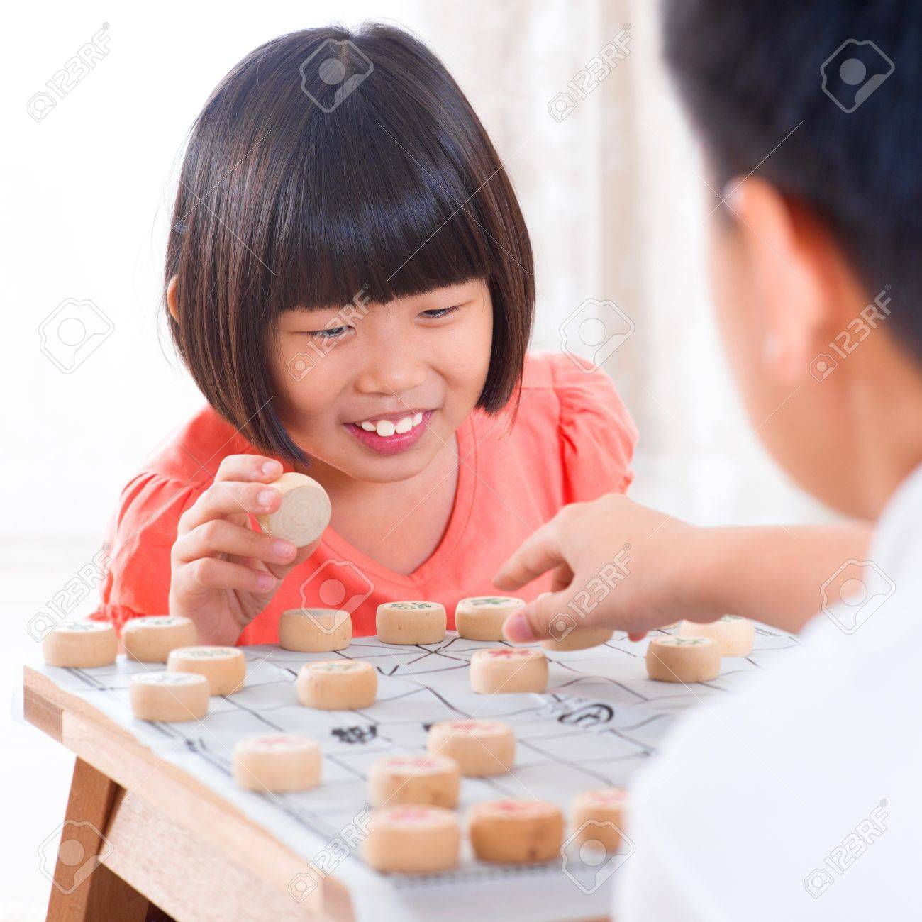 Asian family at home. Asian children playing Chinese chess at home. Stock Photo - 18061182