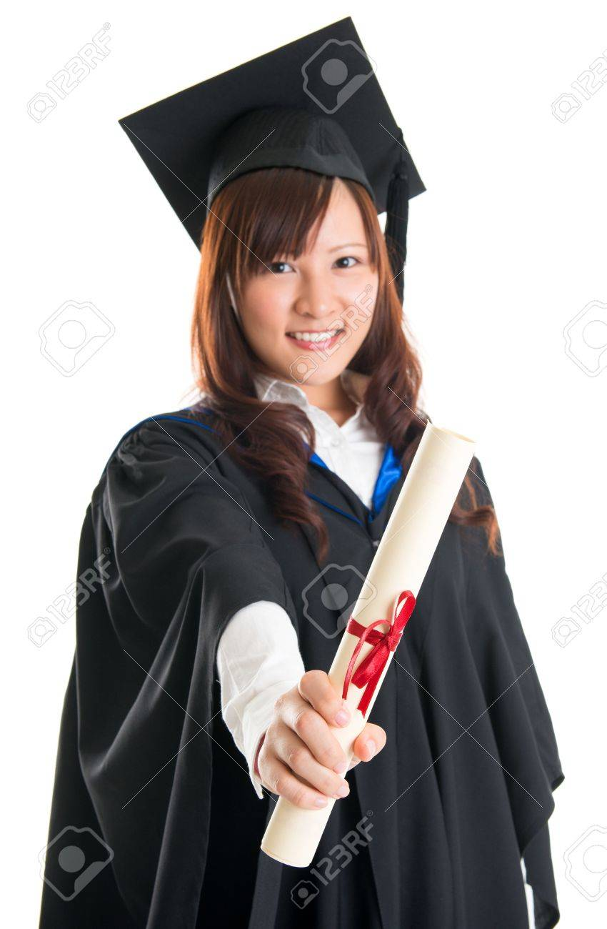 Portrait Of Smiling Asian Female Student In Graduate Gown Showing ...