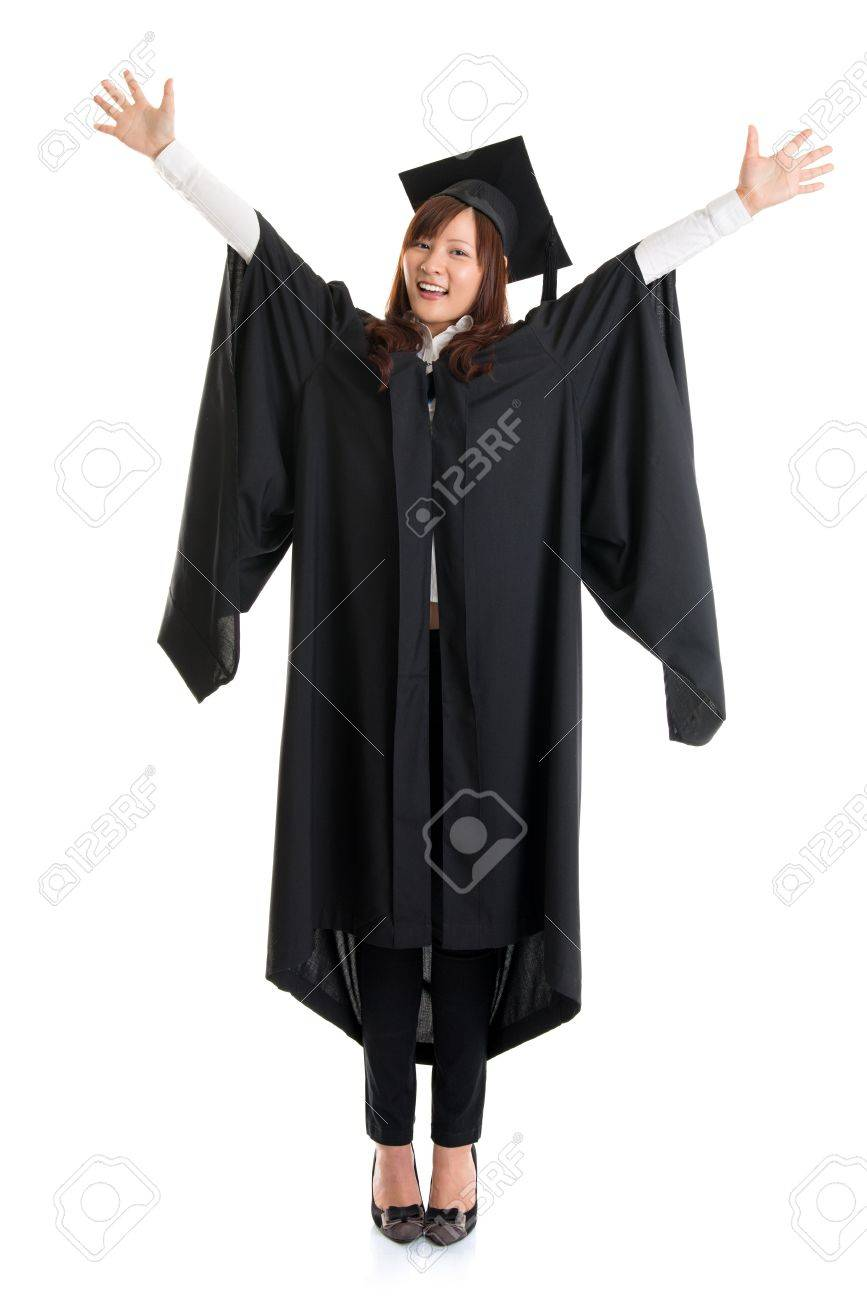 c0c8ff7e246 Excited Asian female in graduation gown hands raised open arms jumping