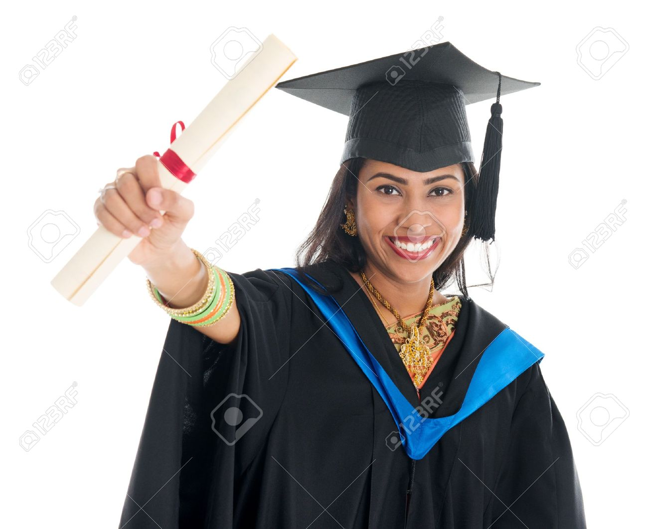 Happy Indian Graduate Student In Graduation Gown And Cap Showing ...